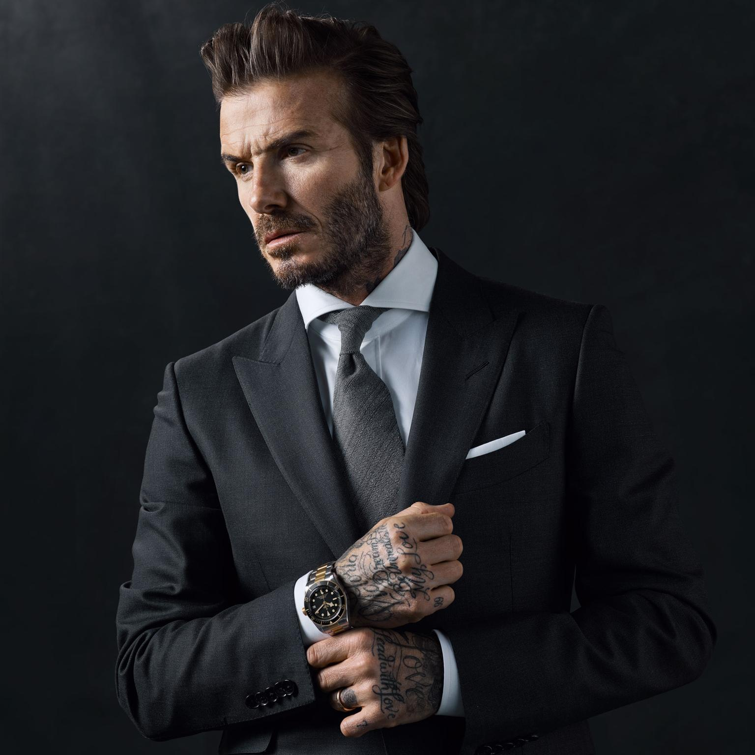 David Beckham for Tudor's Born to Dare watch campaign wearing a suit