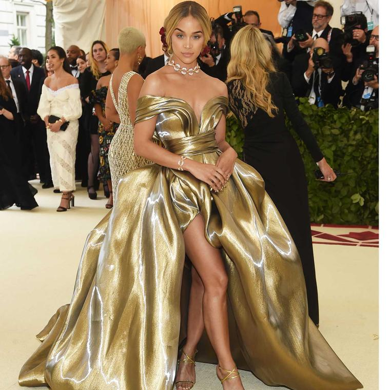 Jasmine Sanders or Golden Barbie in custom-made by H&M golden gown and Bulgari jewels at Met Gala 2018.
