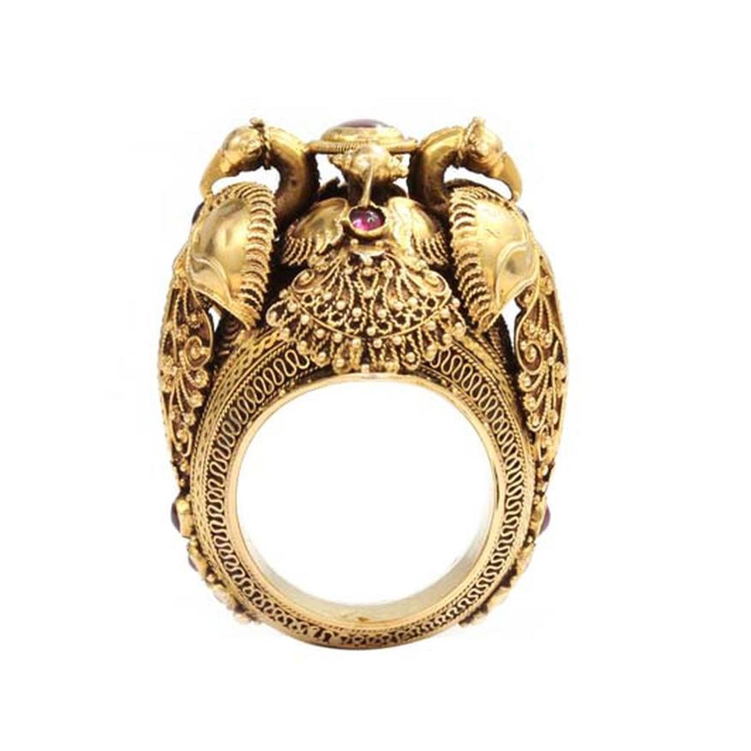 A vintage peacock ring worn by kings, in yellow gold and set with rubies, by C. Krishniah Chetty and Sons.
