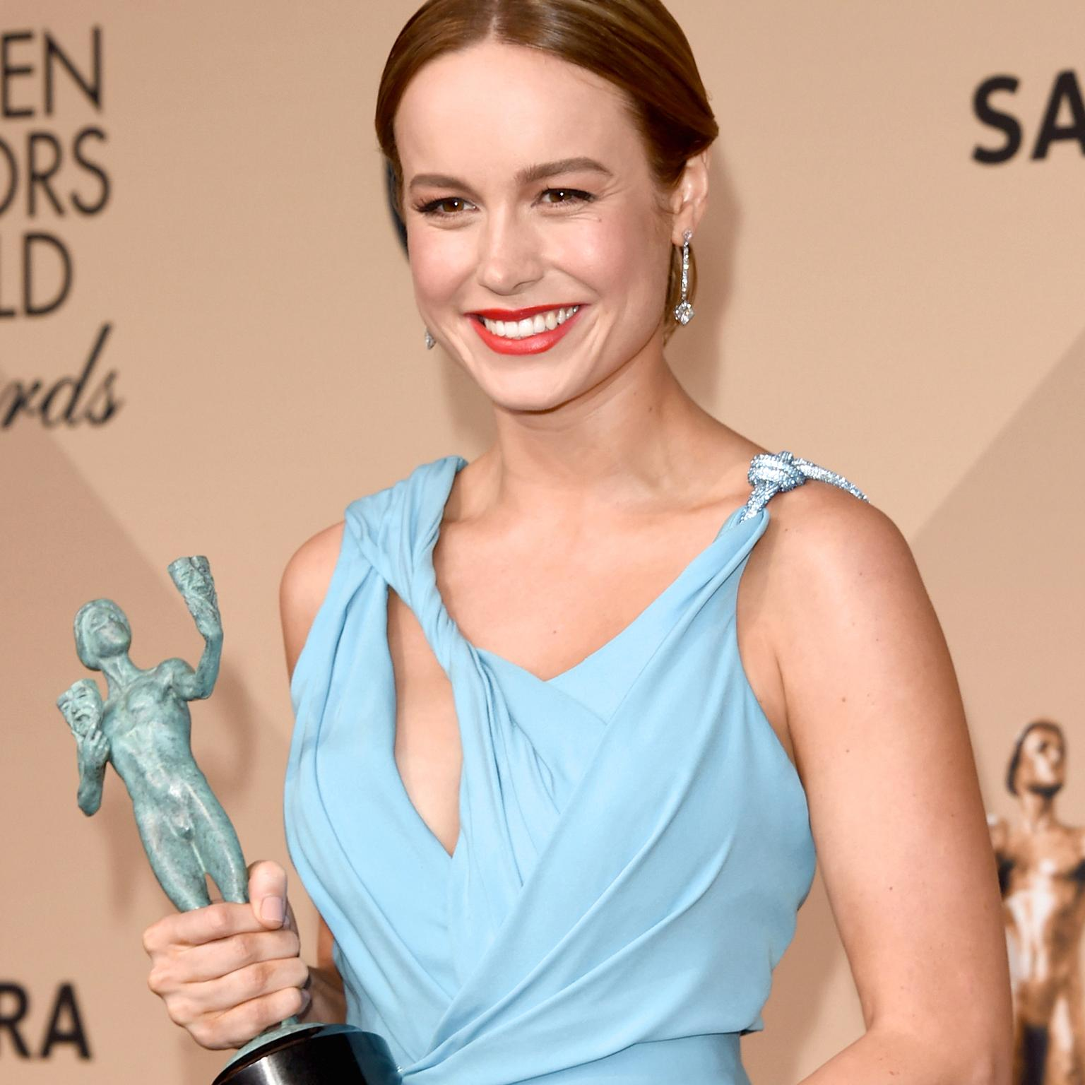 Brie Larson wearing Tiffany red carpet jewelry