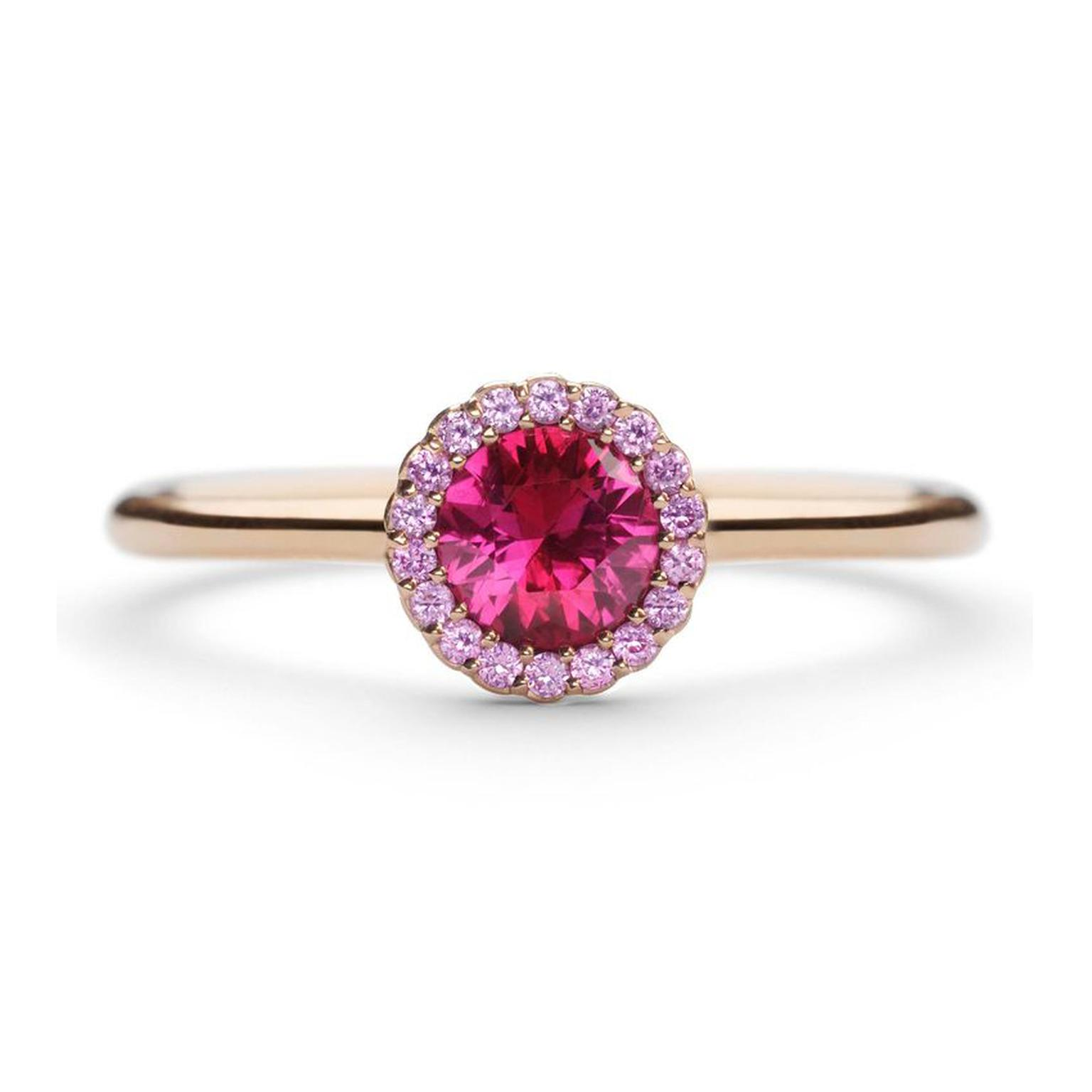 Andrew Geoghegan Cannelé engagement ring in rose gold with a brilliant-cut ruby encircled by pink sapphires.