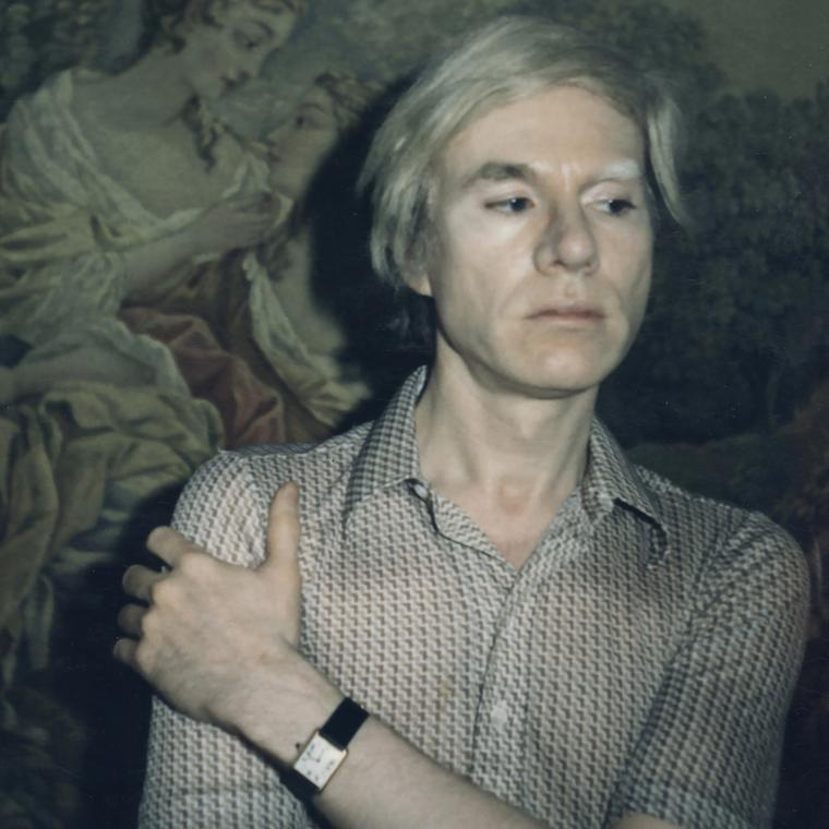 Andy Warhol in his Cartier Tank watch