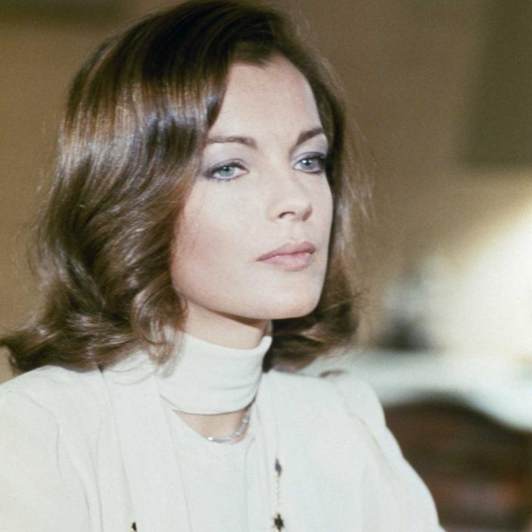 Romy Schneider in 1974 wearing Van Cleef Arpels Alhambra necklace