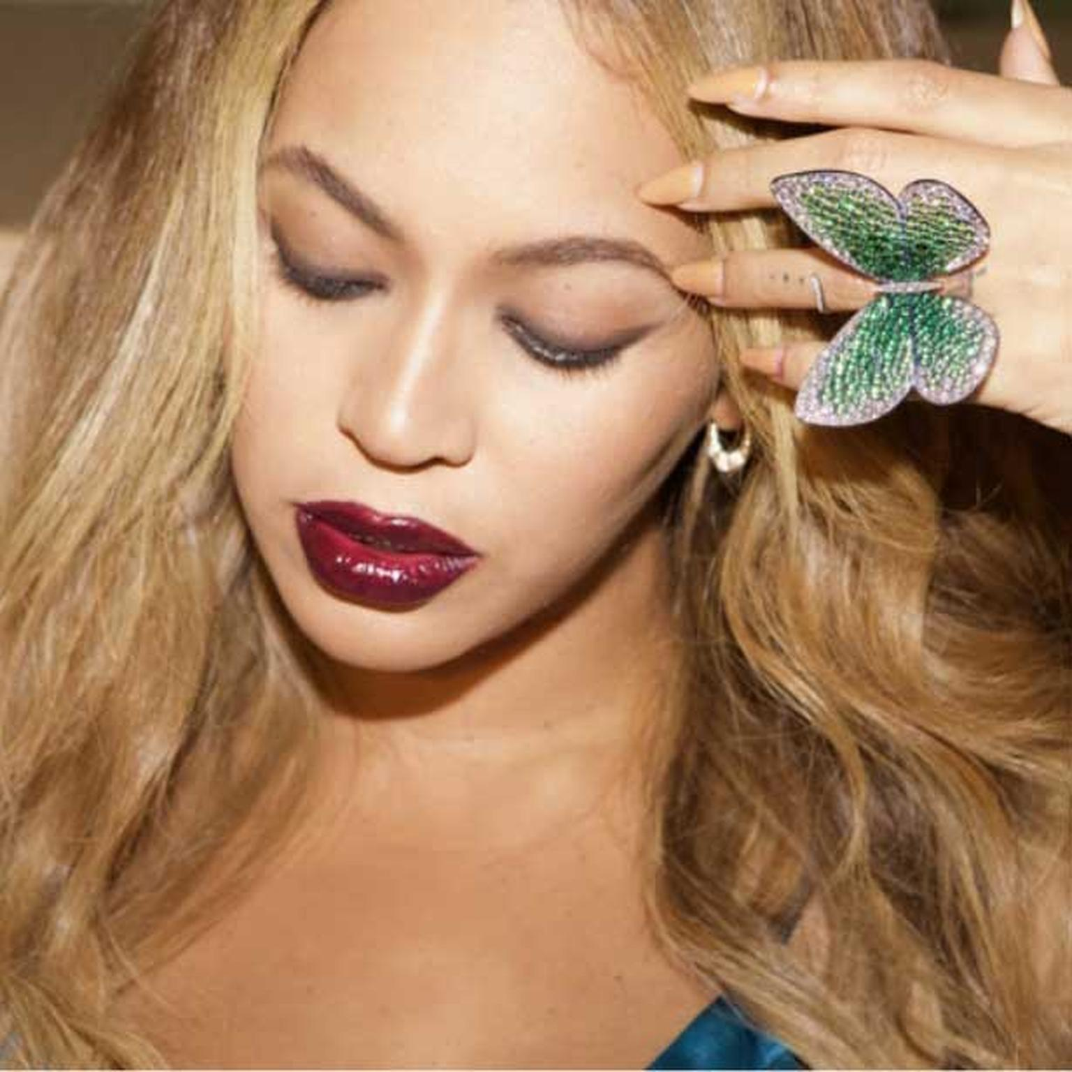 Beyonce wearing Papillon ring by Glenn Spiro in photo taken by Jay Z