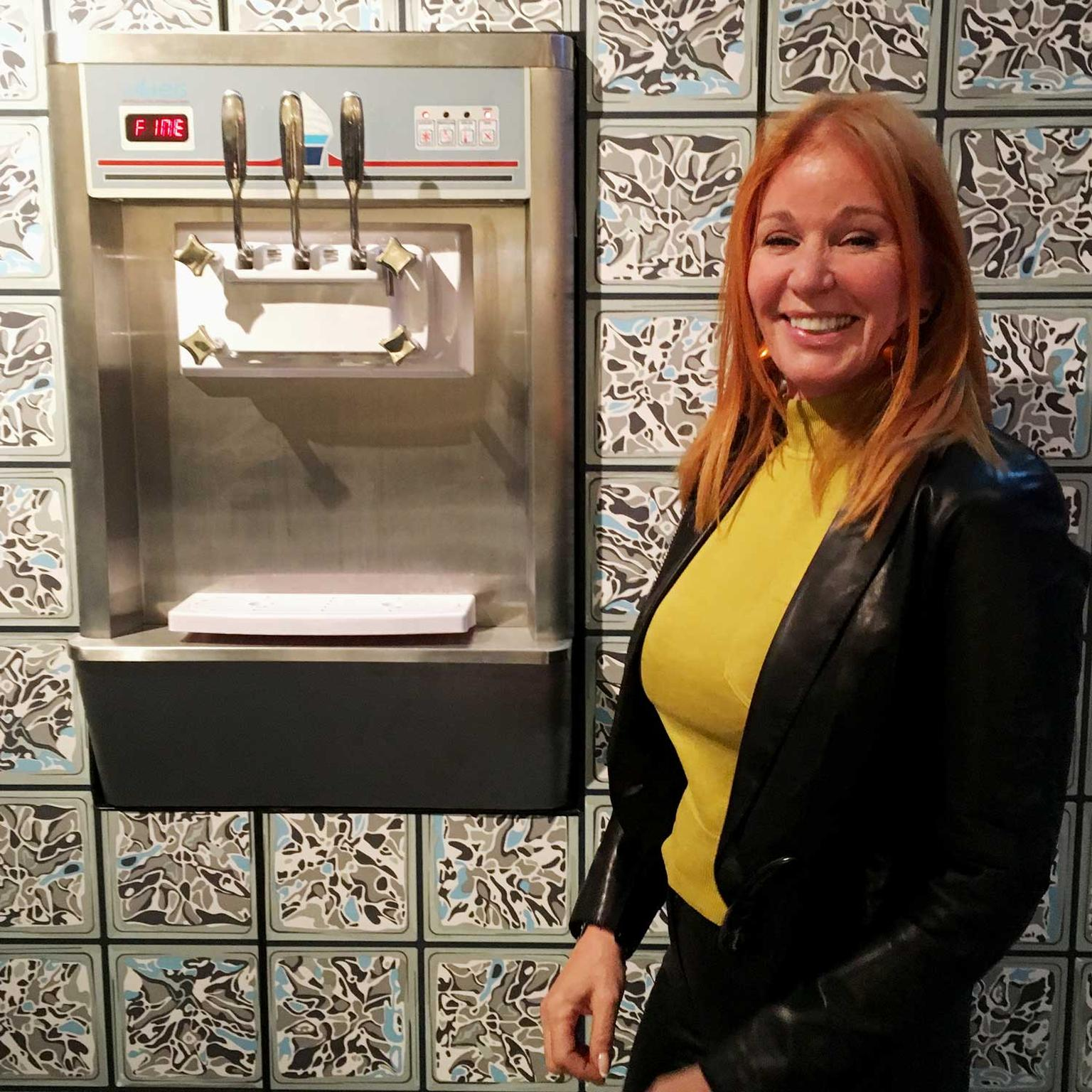 Suzanne Syz beside her Frozen Yogurt machine at PAD London