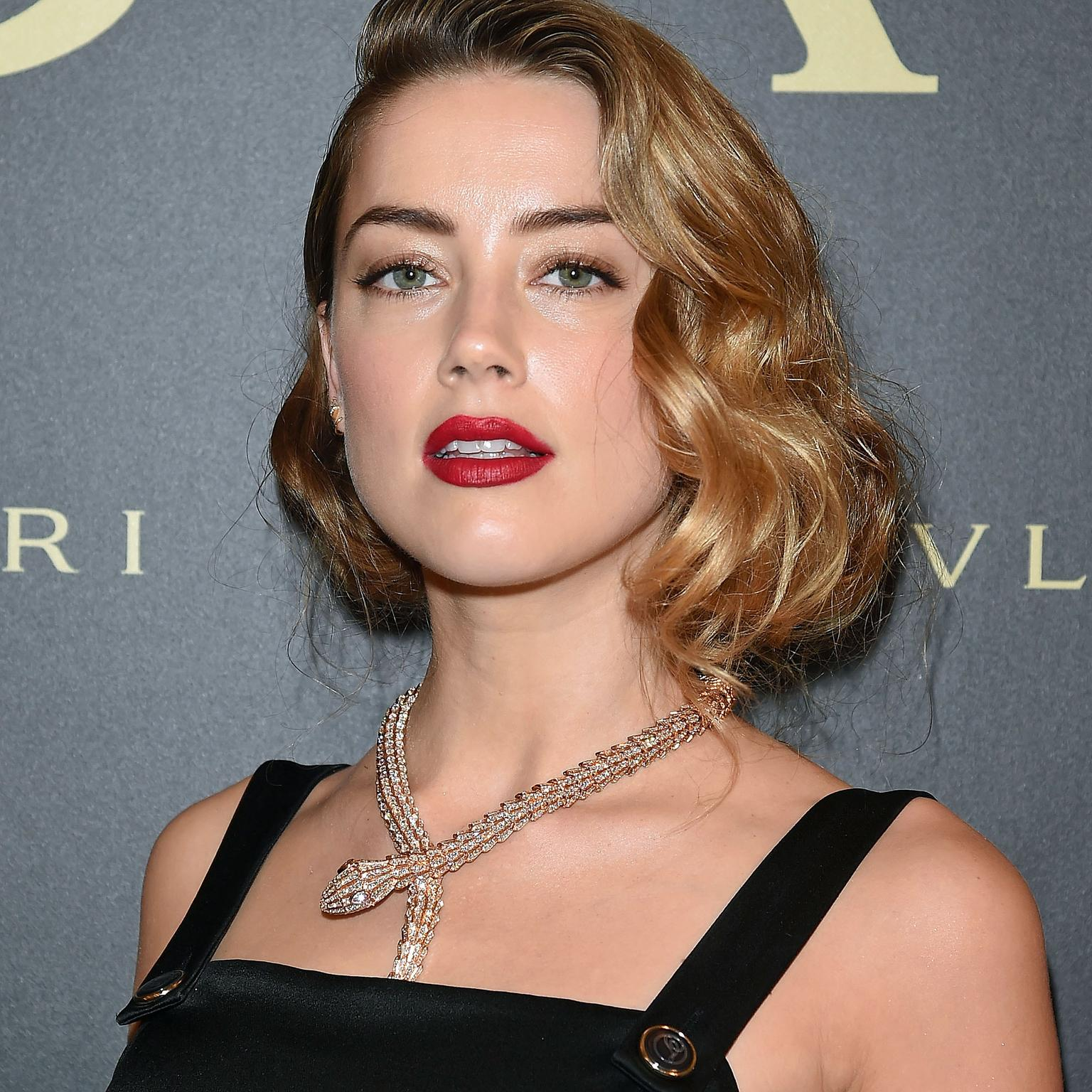Amber Heard wearing Bulgari Serpenti necklace