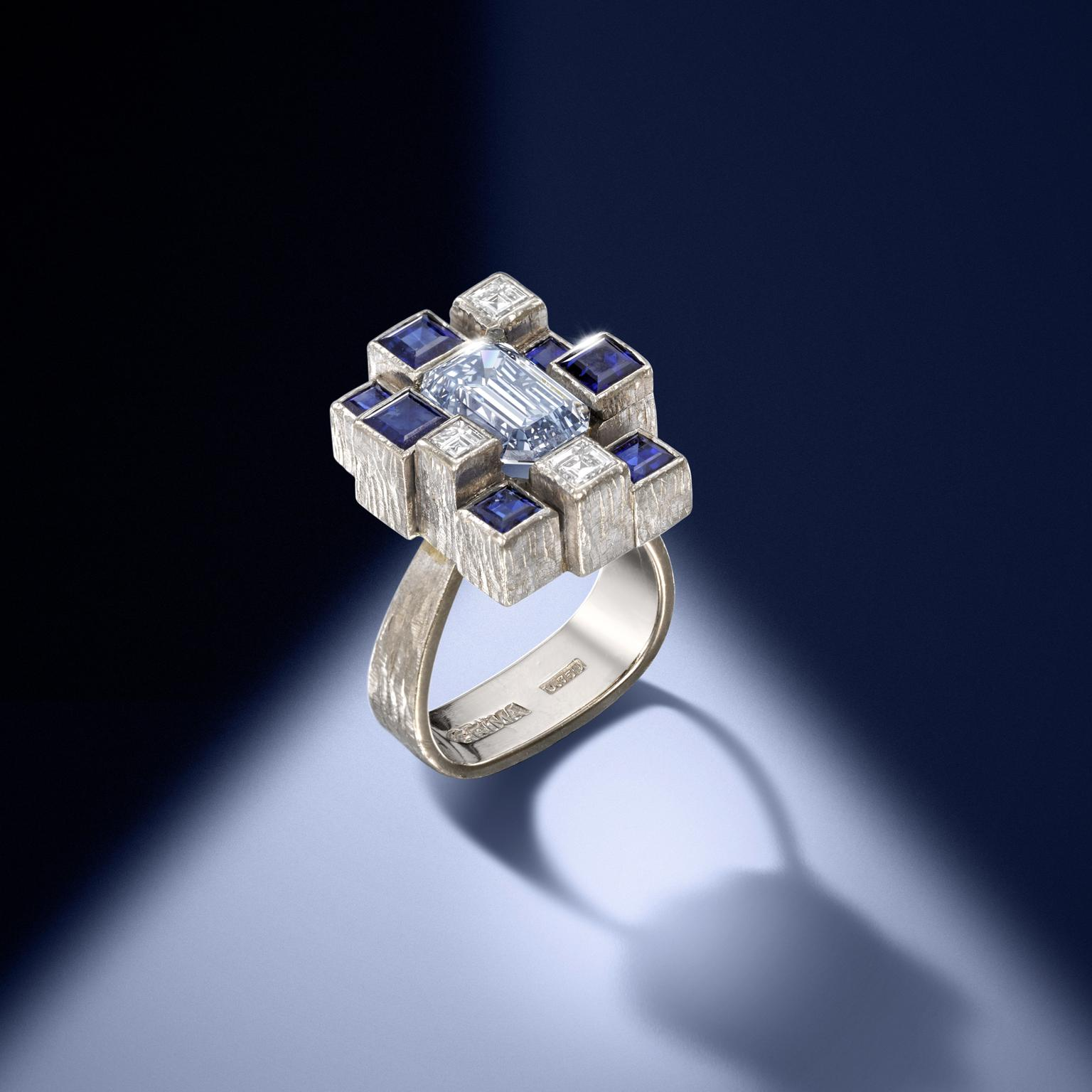 Andrew Grima white gold ring with a grey-blue diamond