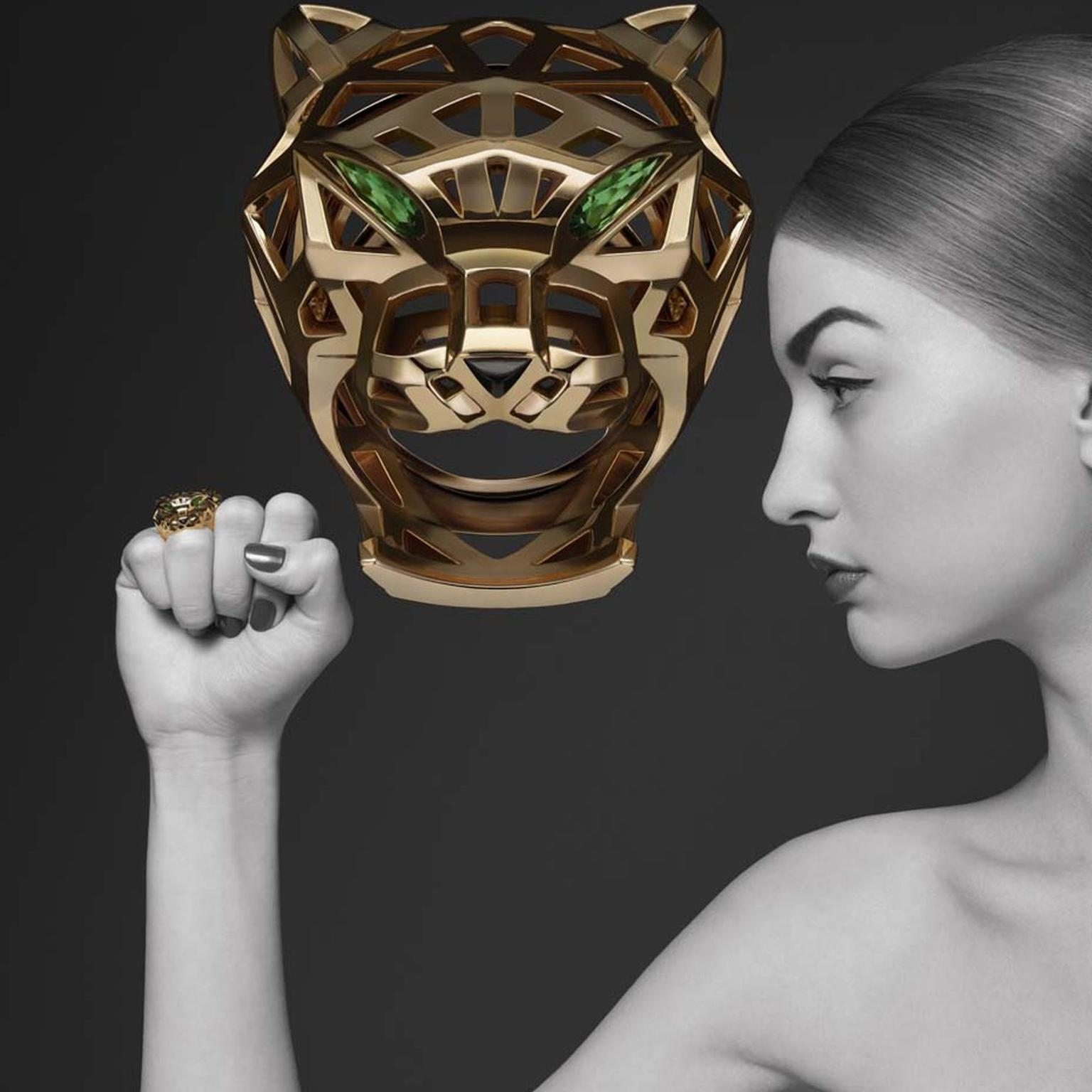 Cartier Panthère de Cartier collection yellow gold ring with onyx, tsavorite and garnets.