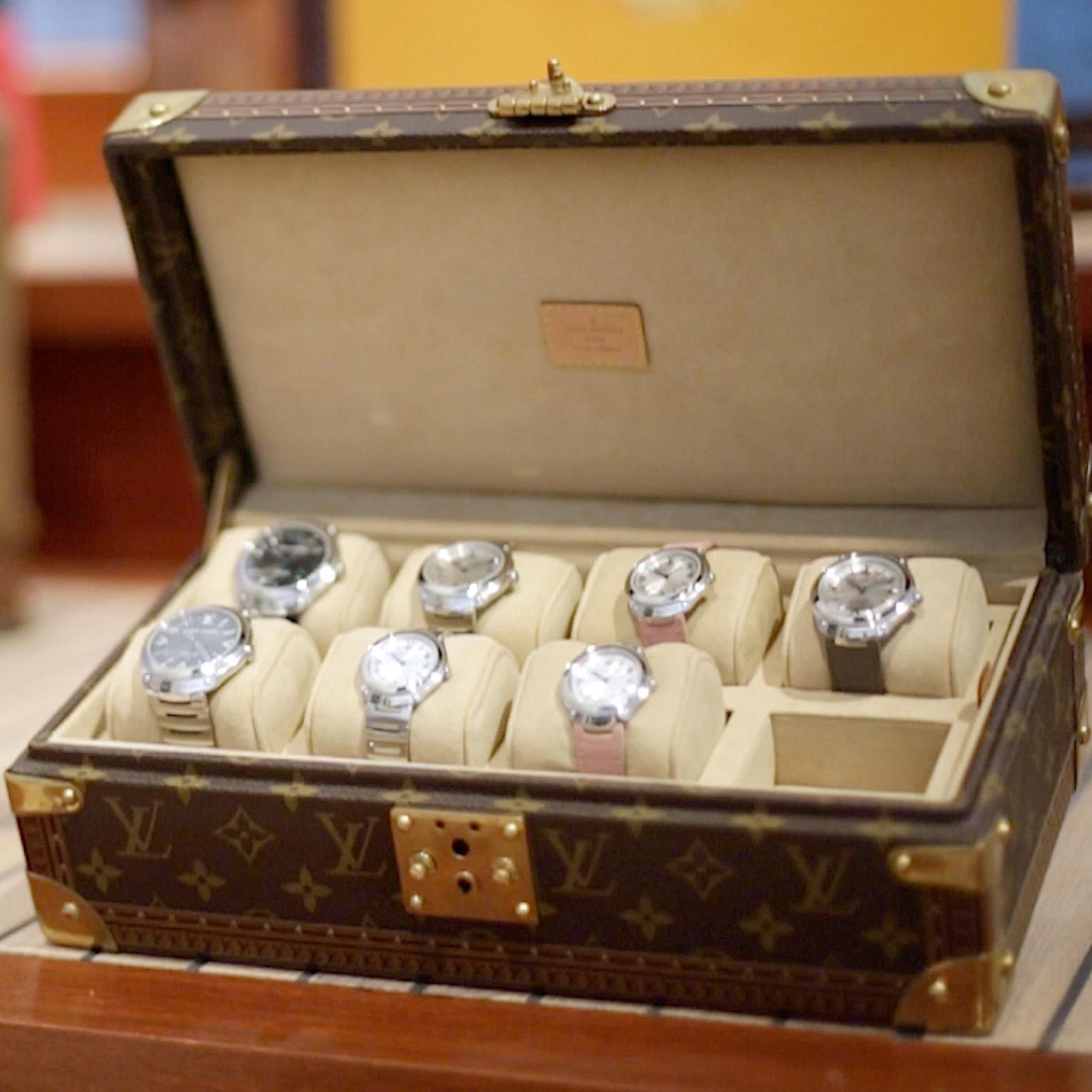 Louis Vuitton Fifty Five watches in LV trunk