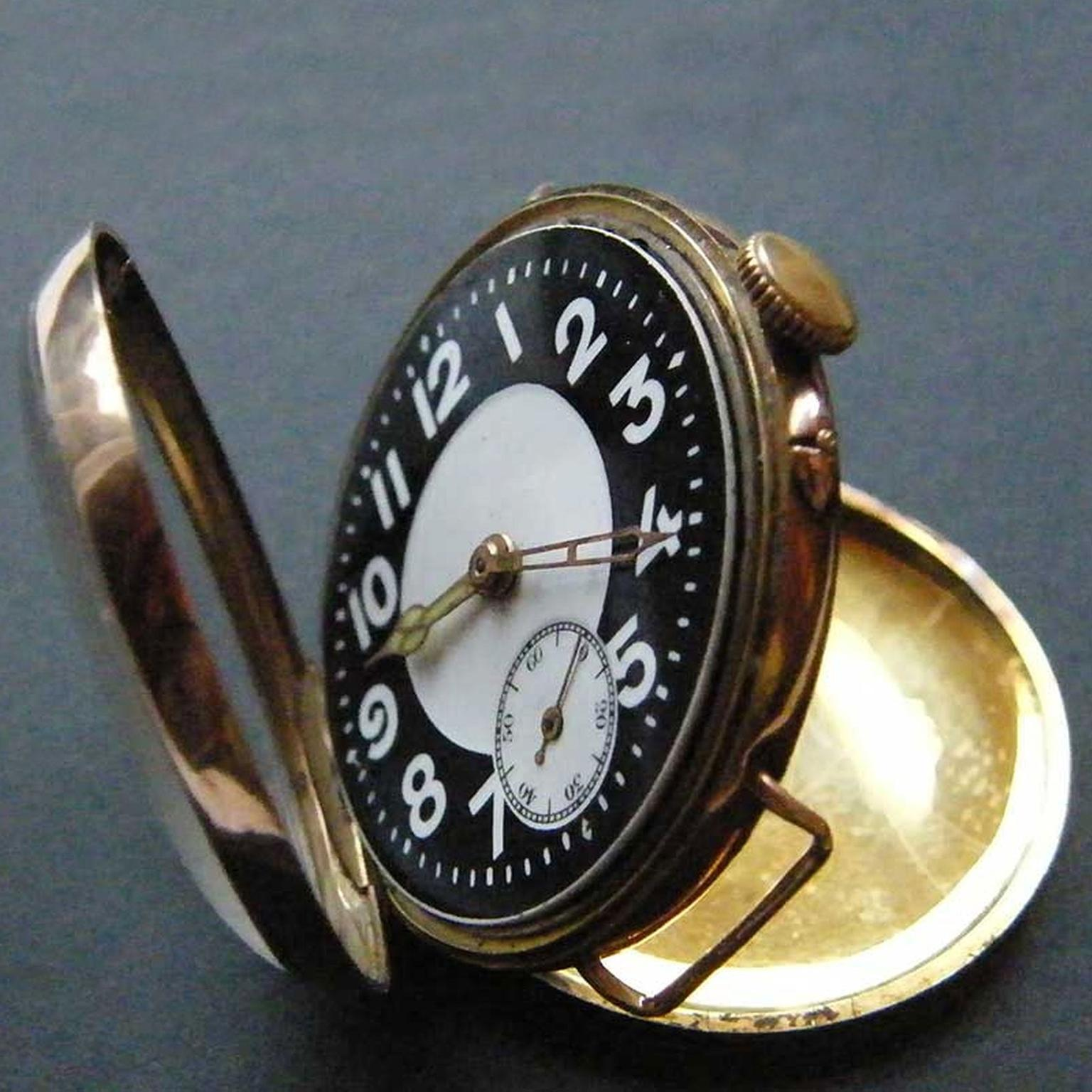 An English military watch from 1916, used by soldiers and pilots during WWI, that illustrates the transition from pocket watch to wristwatch, incorporating features of both.