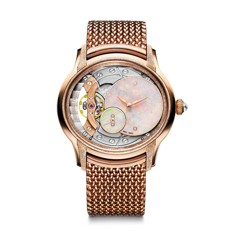 Audemars Piguet Millenary pink gold ladies' watch features an opal dial and exposed workings of the hand-wound calibre.