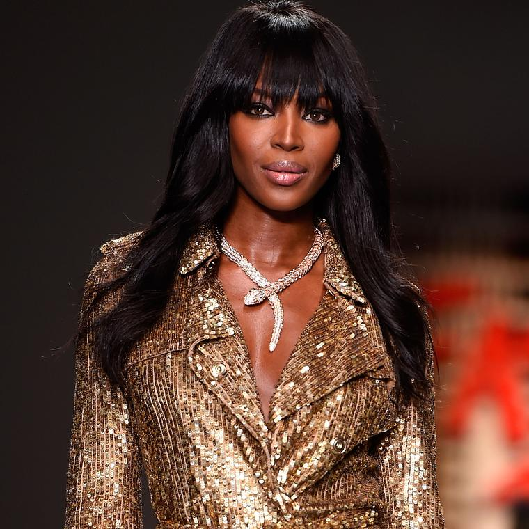 Naomi Campbell wearing Bulgari Serpenti necklace on catwalk