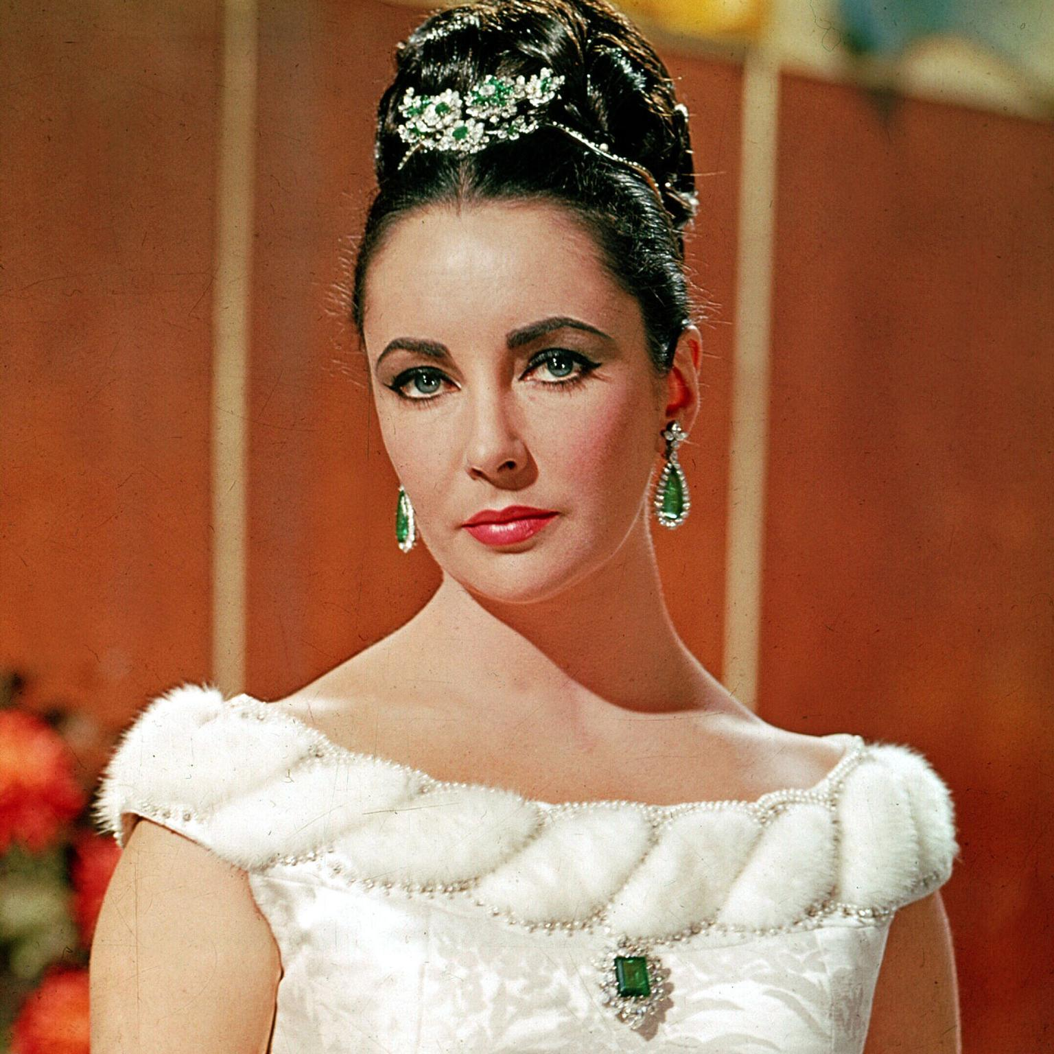 Elizabeth Taylor wearing her Bulgari platinum, emerald and diamond tremblant brooch