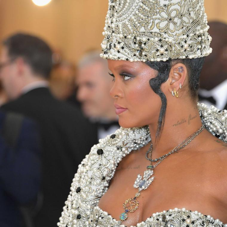 Close up of Rihanna at Met Gala 2018 wearing vintage Cartier necklace.