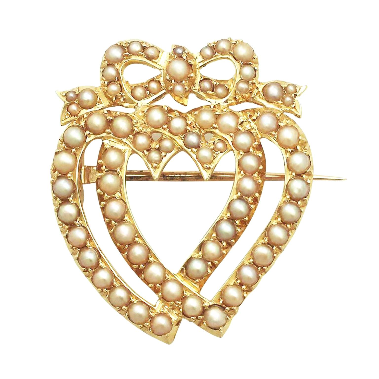 ACS Antiques & Collectibles pearl and yellow gold heart entwined brooch