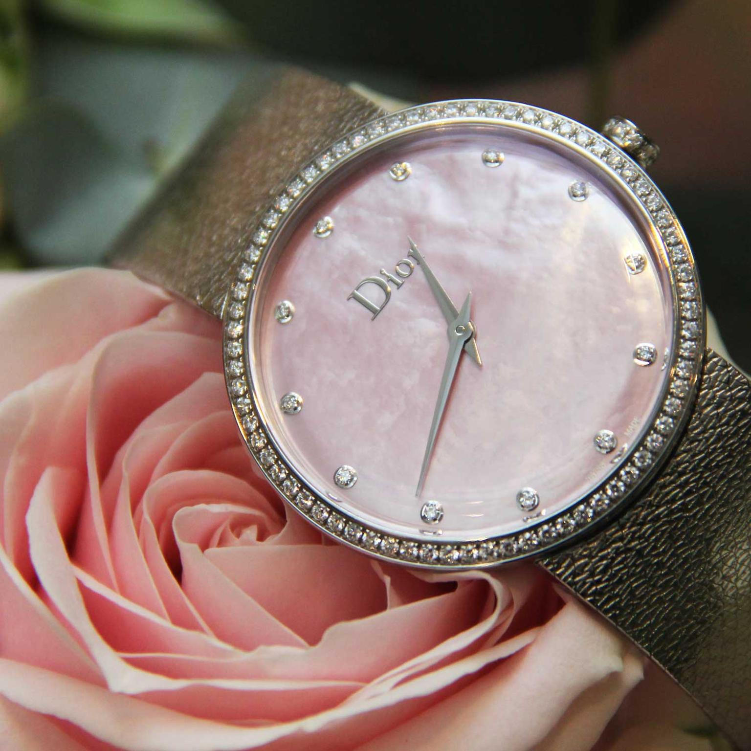 La D de Dior Satine watch with a pink mother-of-pearl dial