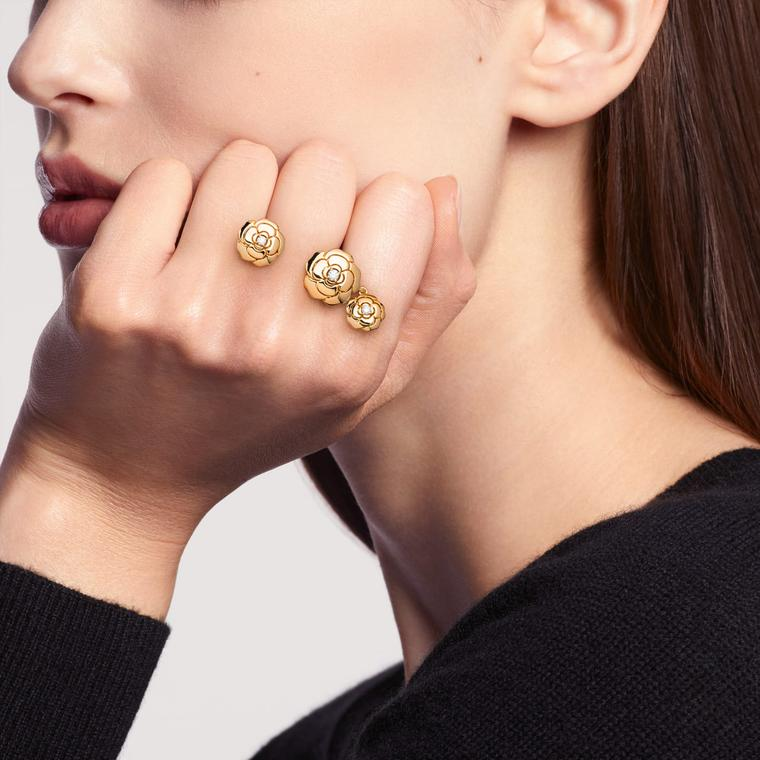 Chanel extrait de camelia charms ring on model