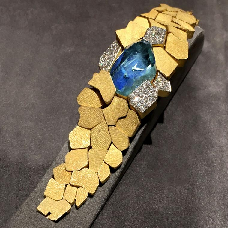 Andrew Grima 1969 Omega watch in gold with a blue topaz dial, seen at TEFAF 2017