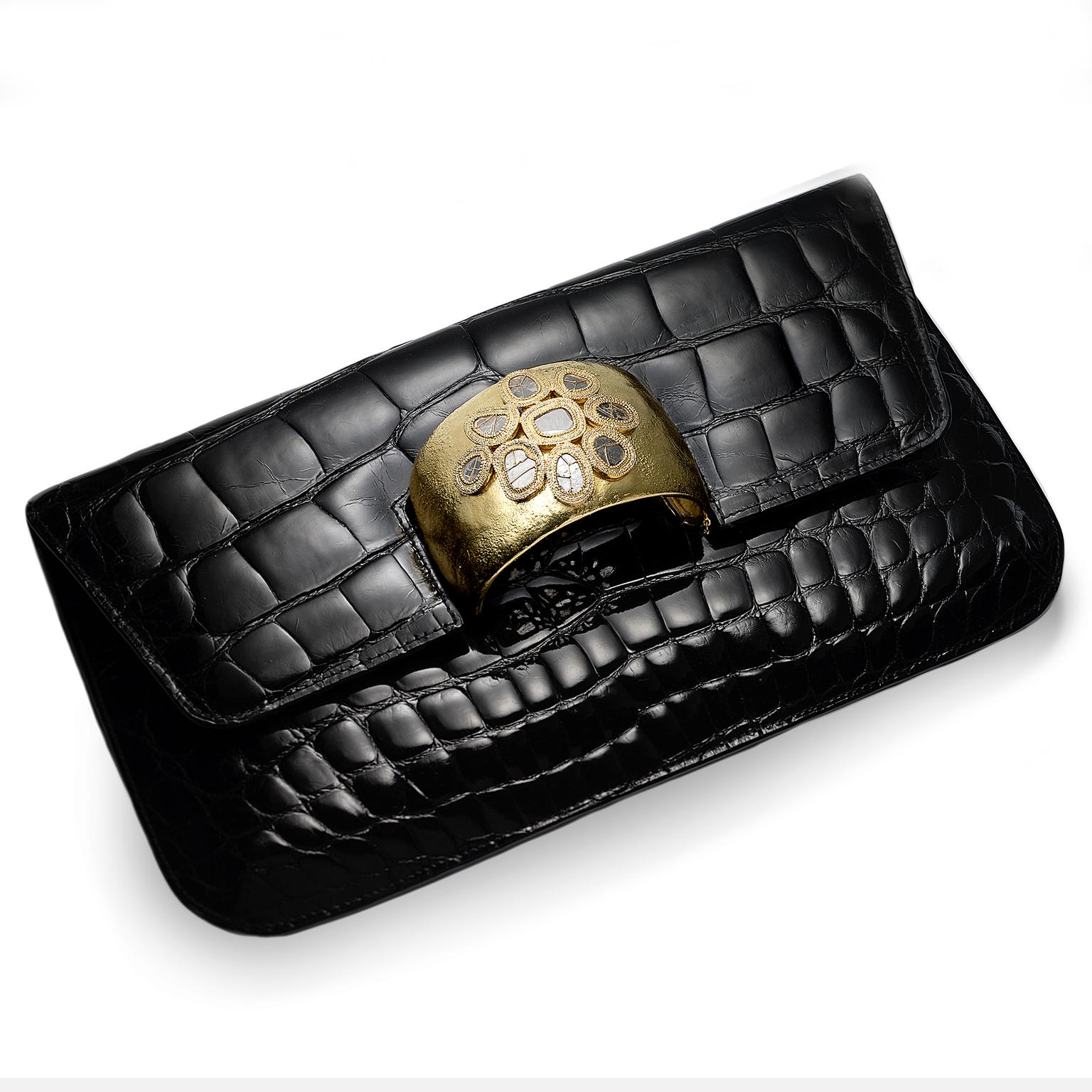 Coomi black leather bag with gold cuff