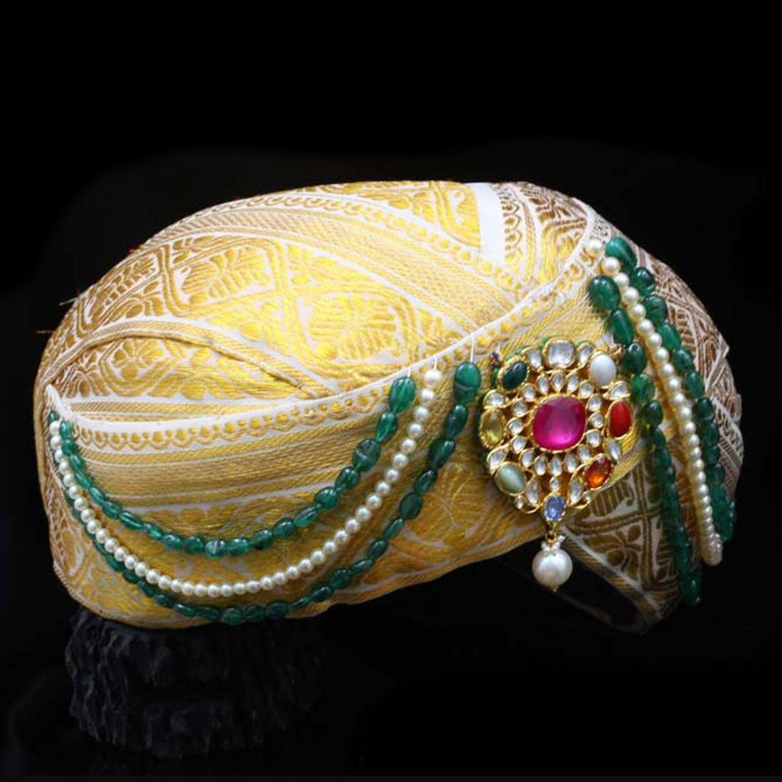 A Navratna turban with its sacred combination of nine gemstones by C. Krishniah Chetty and Sons.