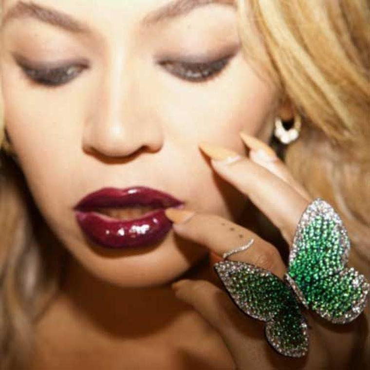 Close up of Beyonce wearing Papillon ring by Glenn Spiro in photo taken by Jay Z