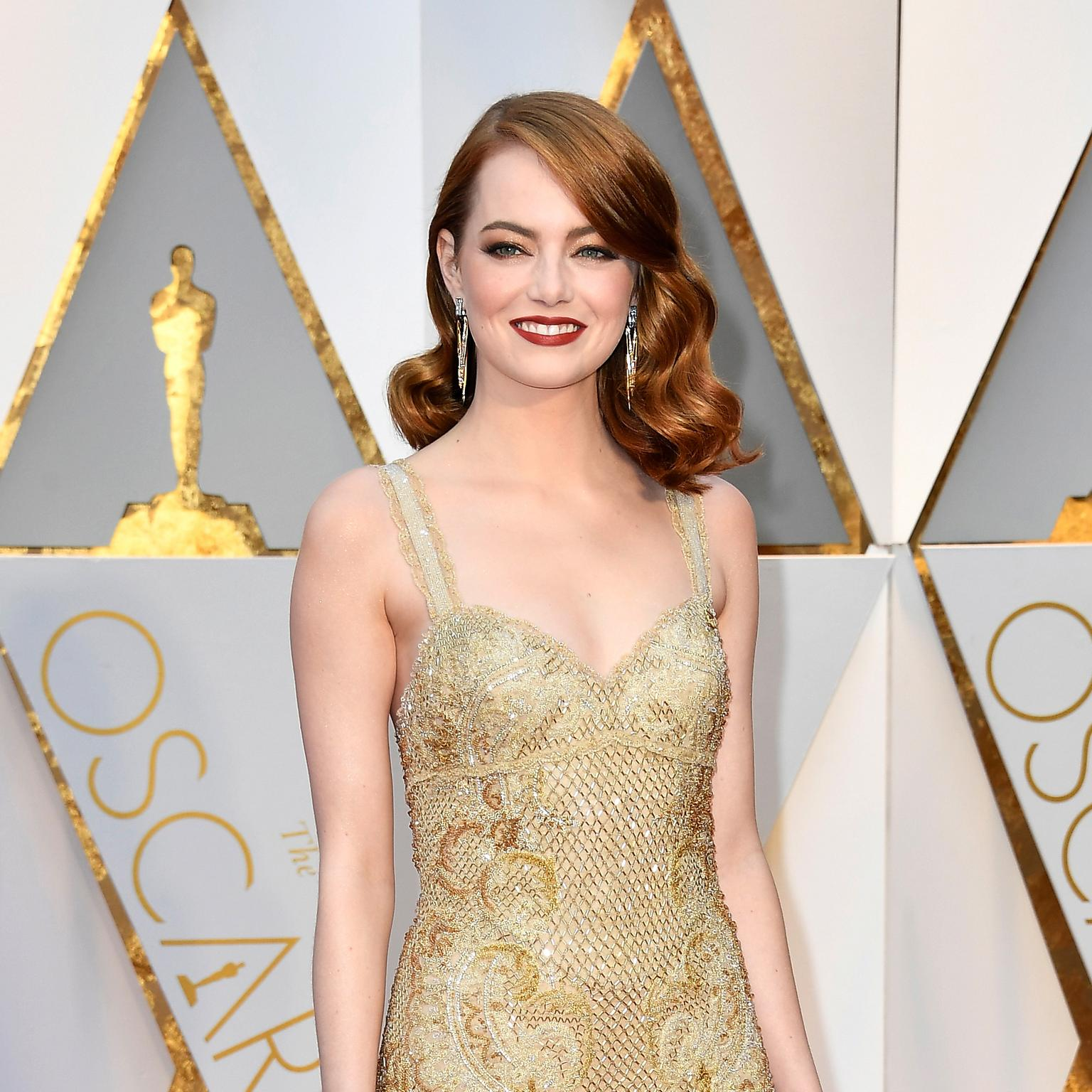 Emma Stone on the Oscars red carpet wearing Tiffany Whispers of the Rain Forest earrings from the 2017 Book Collection
