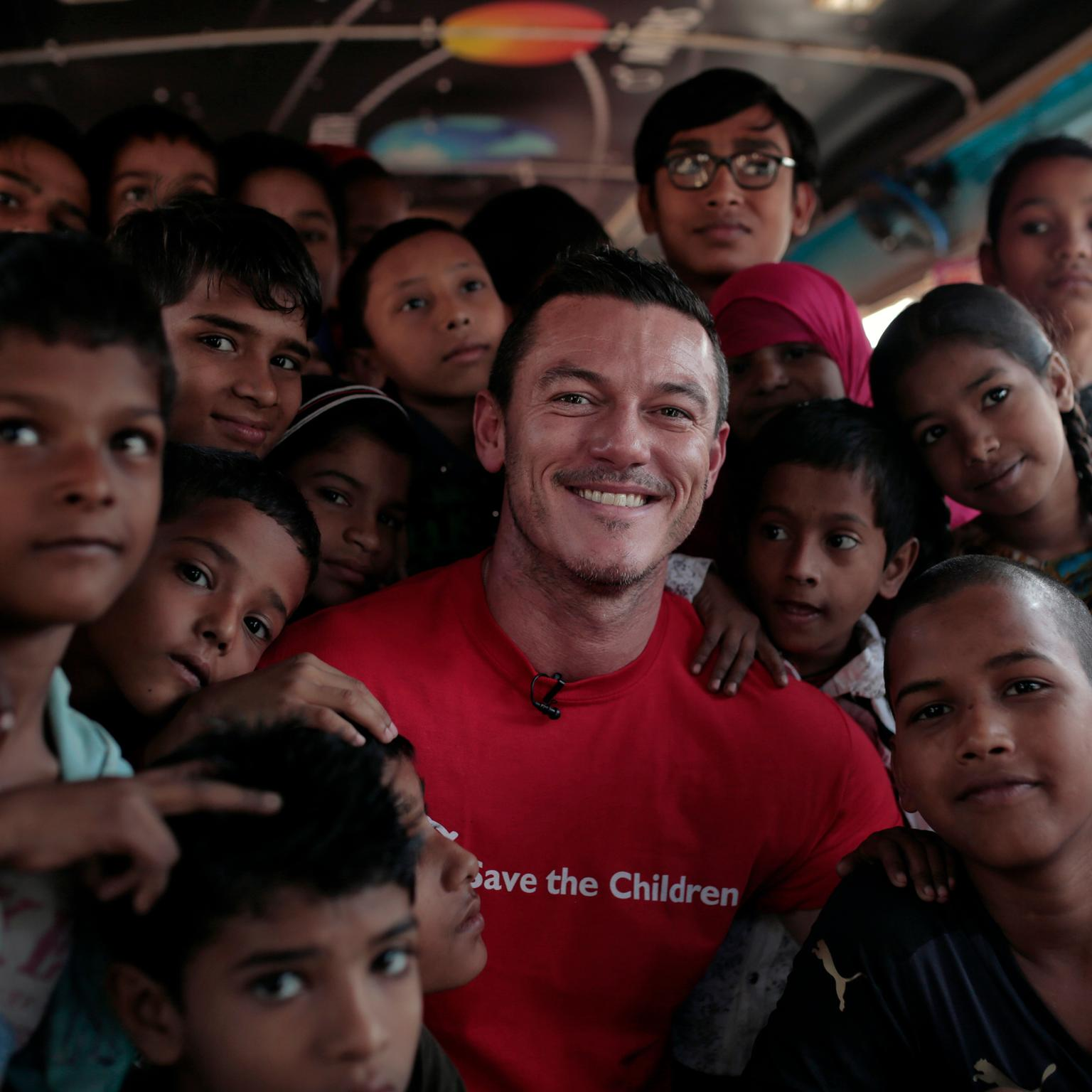 Luke Evans with pupils in India raising money for Save the Children