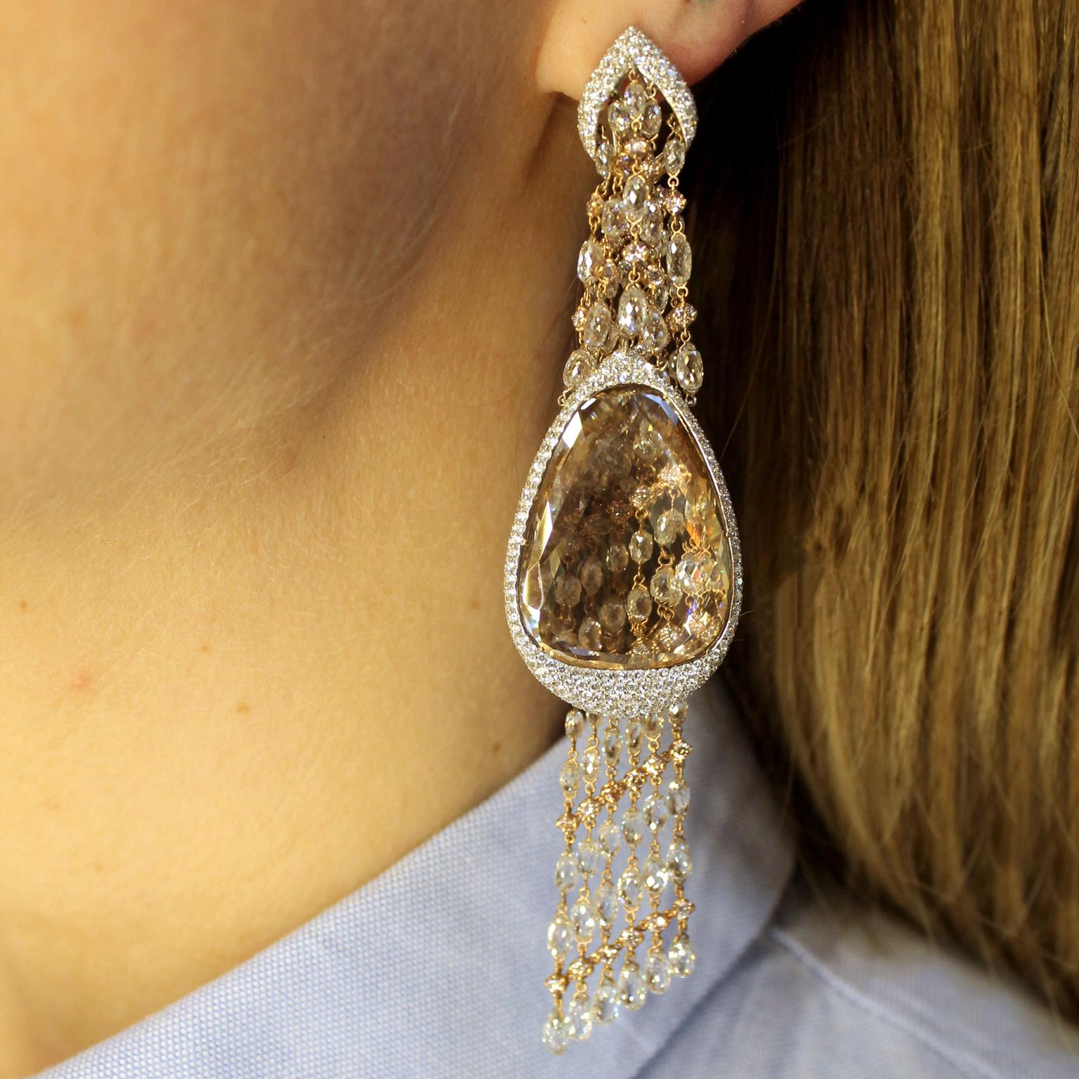 Moussaieff portrait diamond chandelier earrings on model