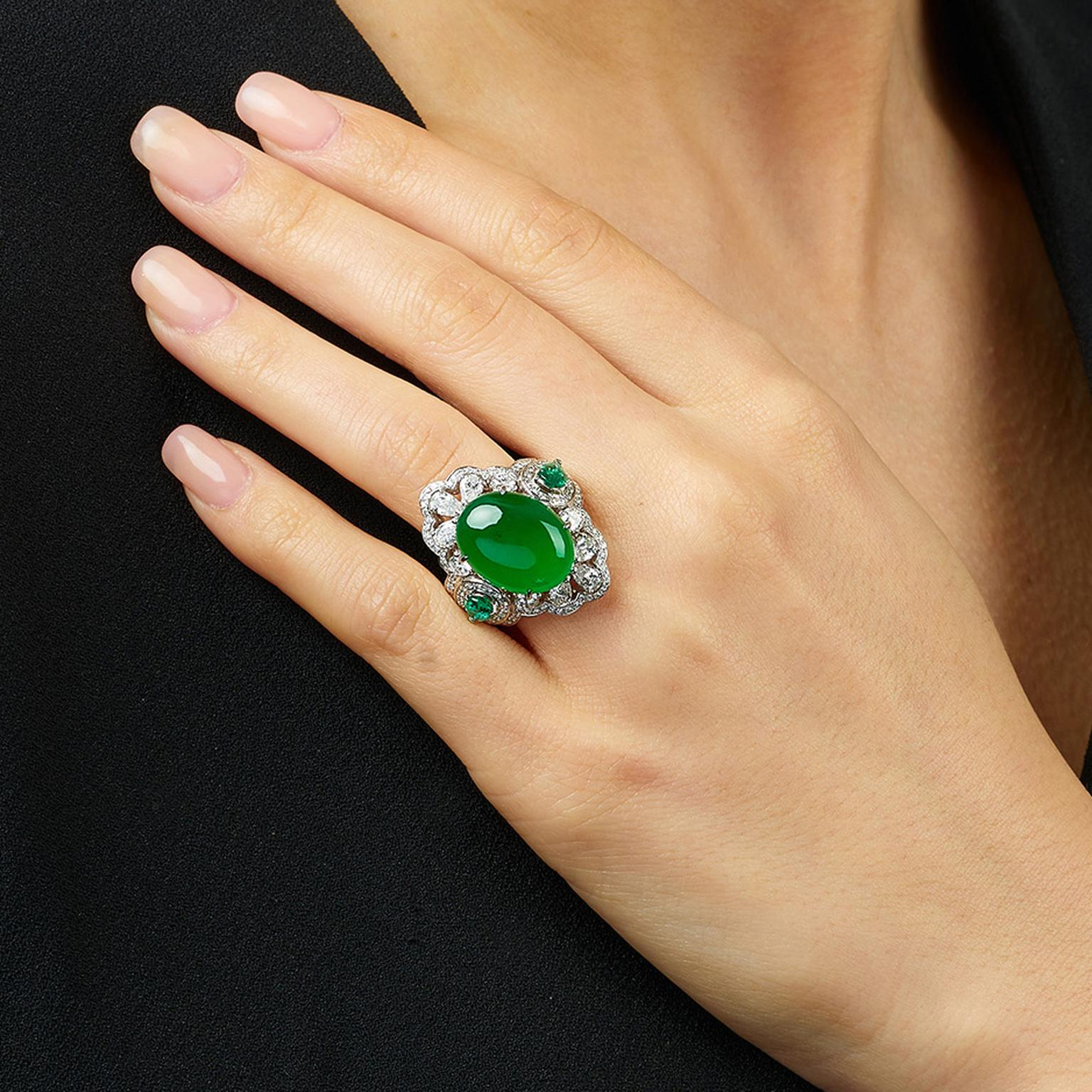 Lot 581 Jadeite Emerald and diamond ring for Phillips on model