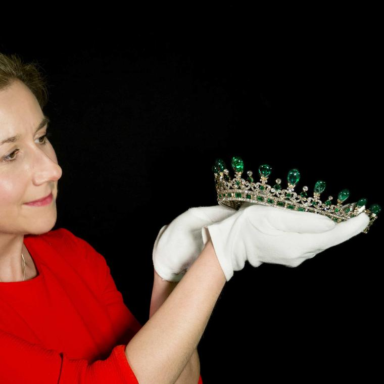 A-conservator-prepares-Queen-Victorias-Diamond-and-Emerald-Diadem