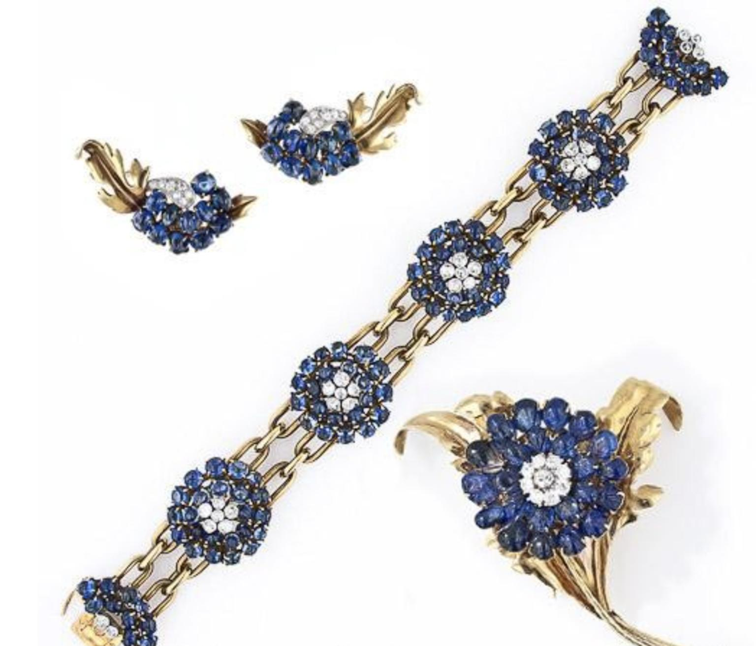 Chaulmet sapphire pin, bracelet and earrings suite sold by Lang Antiques