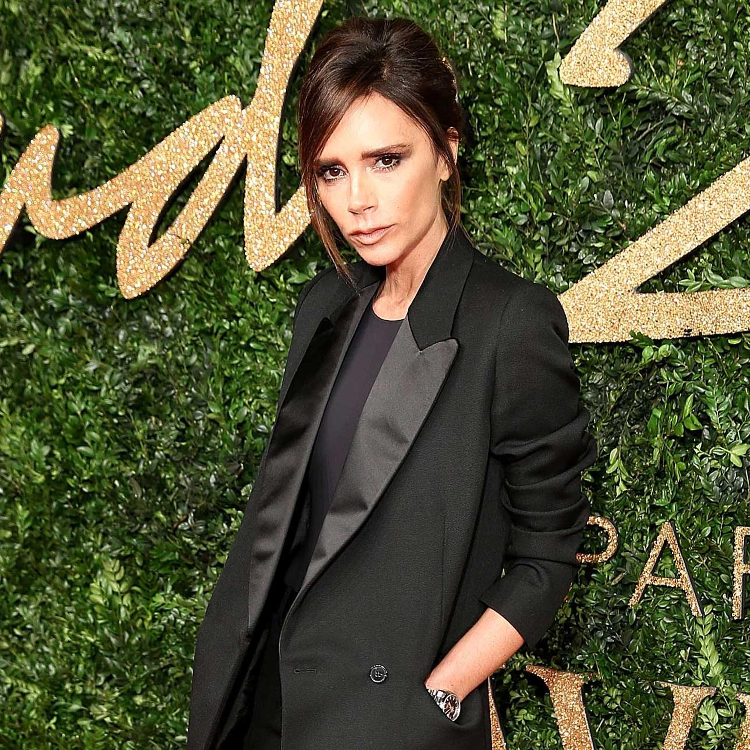 Victoria Beckham accessorised with a Rolex watch at the British Fashion Awards