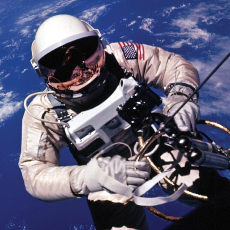 Edward White undertakes his first spacewalk