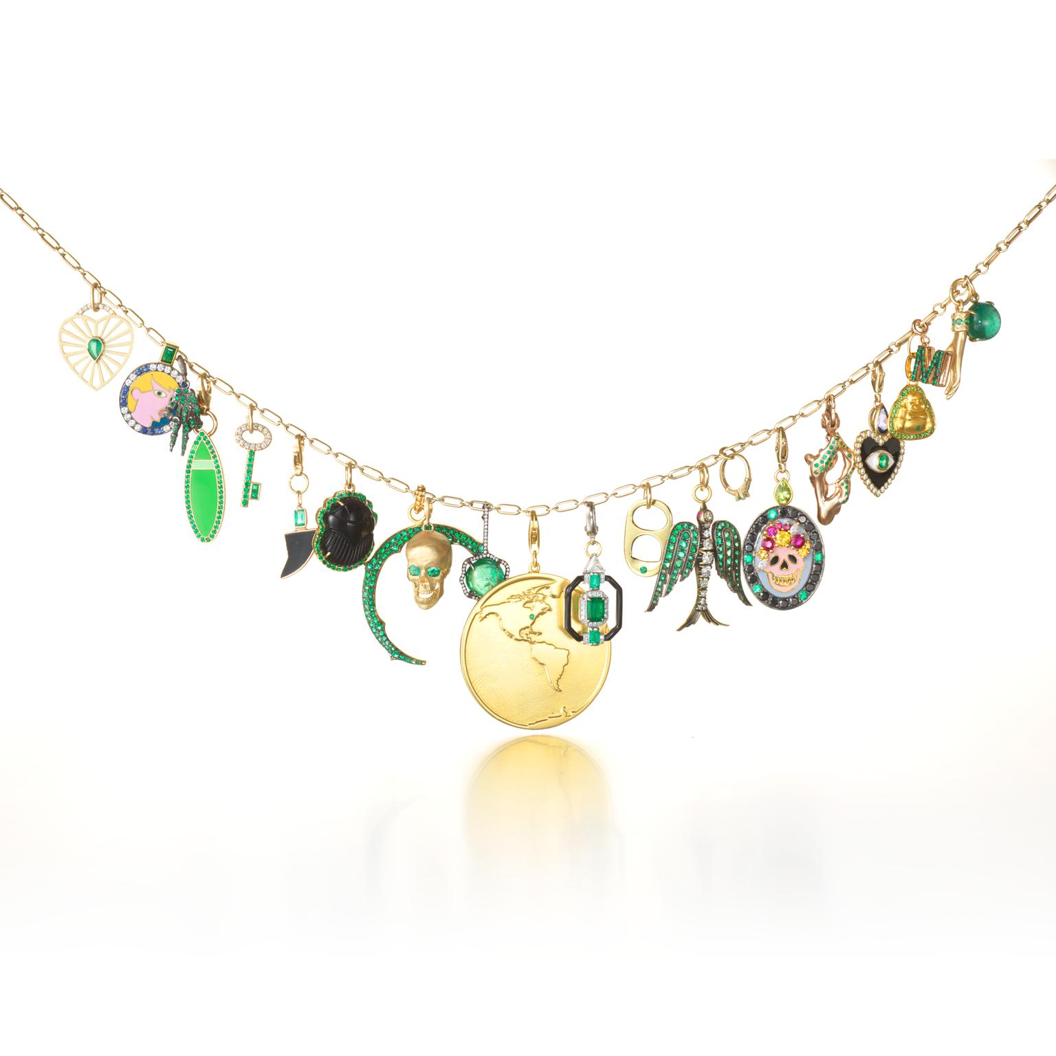 Muse x Gemfields charm necklace with emeralds
