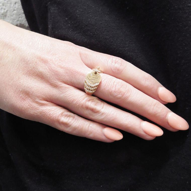 Nouvel Heritage rose gold signet ring on model