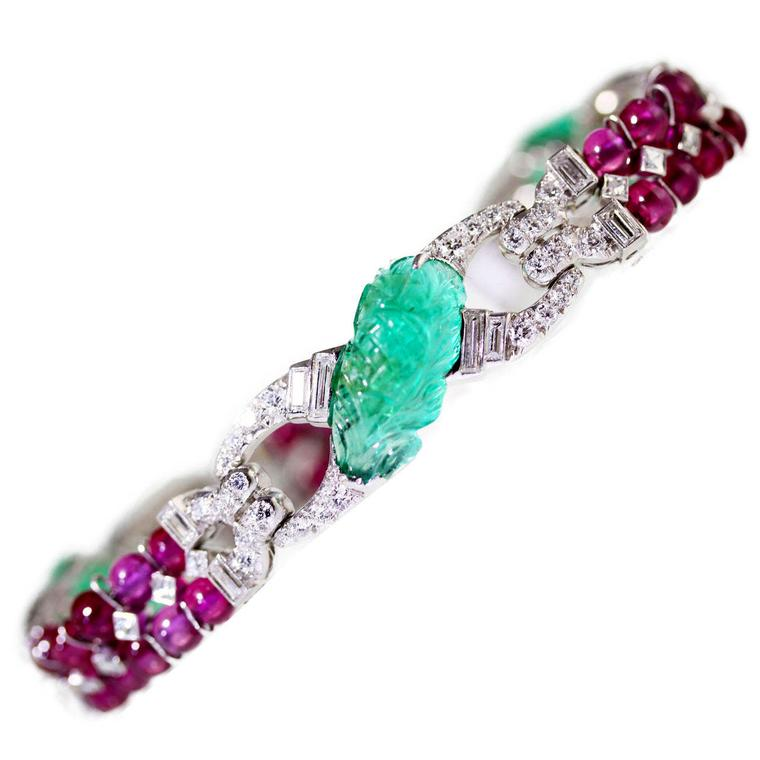 JS Fearnley Art Deco ruby, diamond and carved emerald bracelet