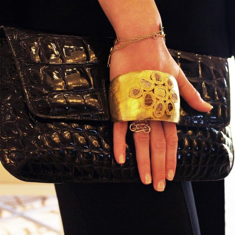 Coomi black crocodile leather bag with gold cuff