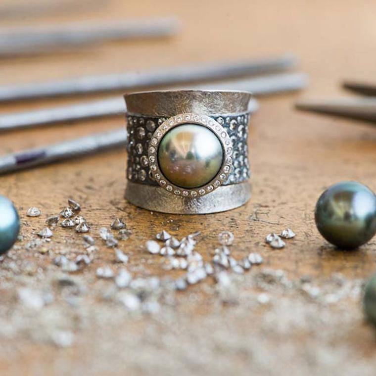 One of Todd Reed's new Tahitian pearl rings on the work bench at his newly expanded studio in Boulder, Colorado