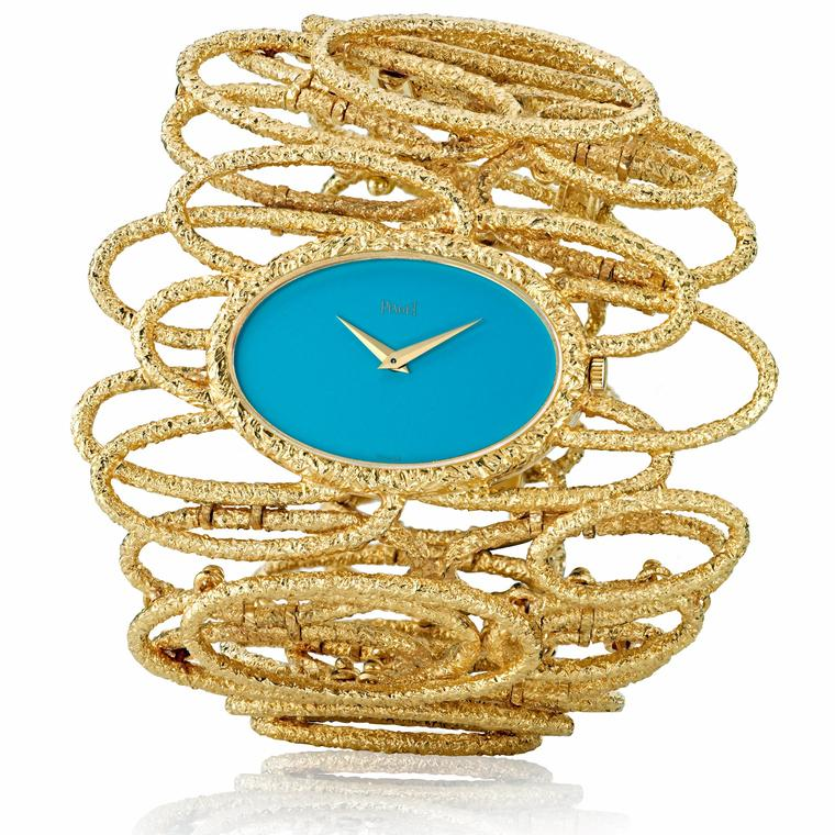 Piaget vintage cuff watch in yellow gold with a turquoise dial