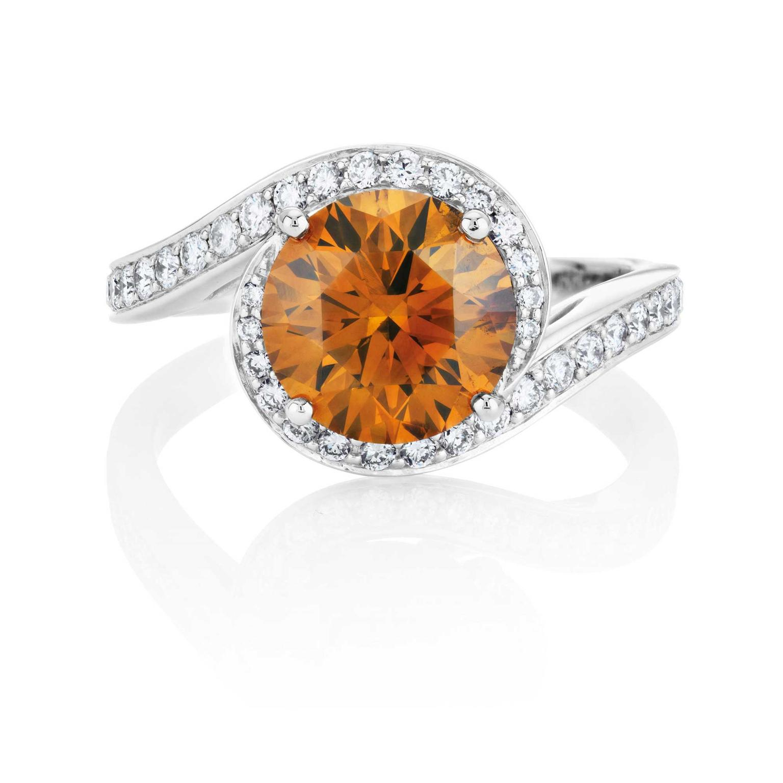 De Beers Caress round brilliant Fancy Deep brown orange diamond ring