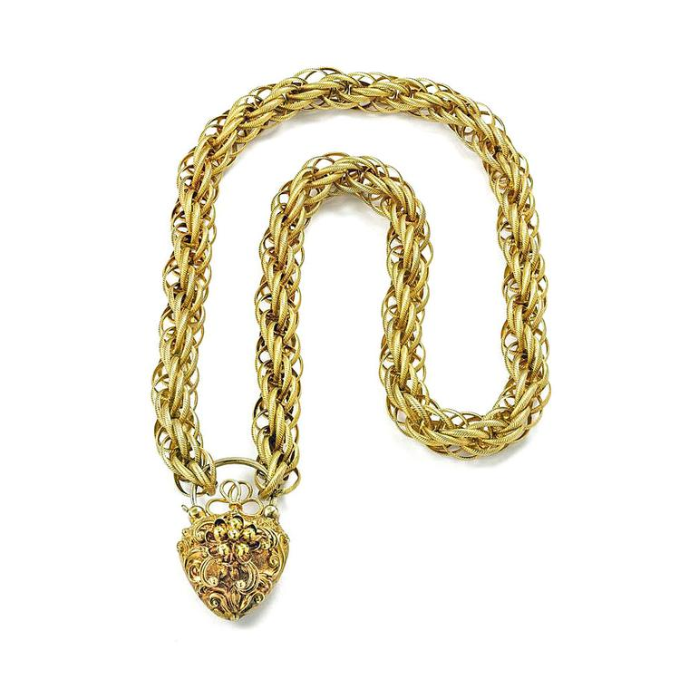 Bentley and Skinner gold chain with heart locket