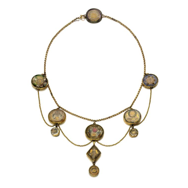 Sotheby's gold necklace mounted with Stuart crystal mourning slides and buttons