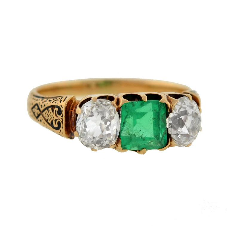 A. Brandt + Son three-stone emerald and old mine-cut diamond ring