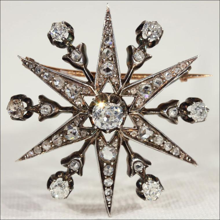 Antique brooches Victoria Sterling silver-topped gold star pin with diamonds