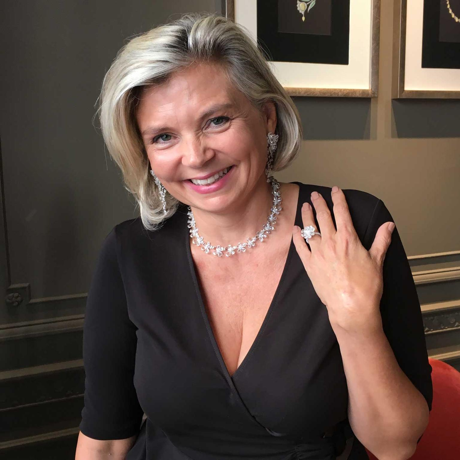 Maria Doulton trying on Nirav Modi's Jasmine diamond jewellery