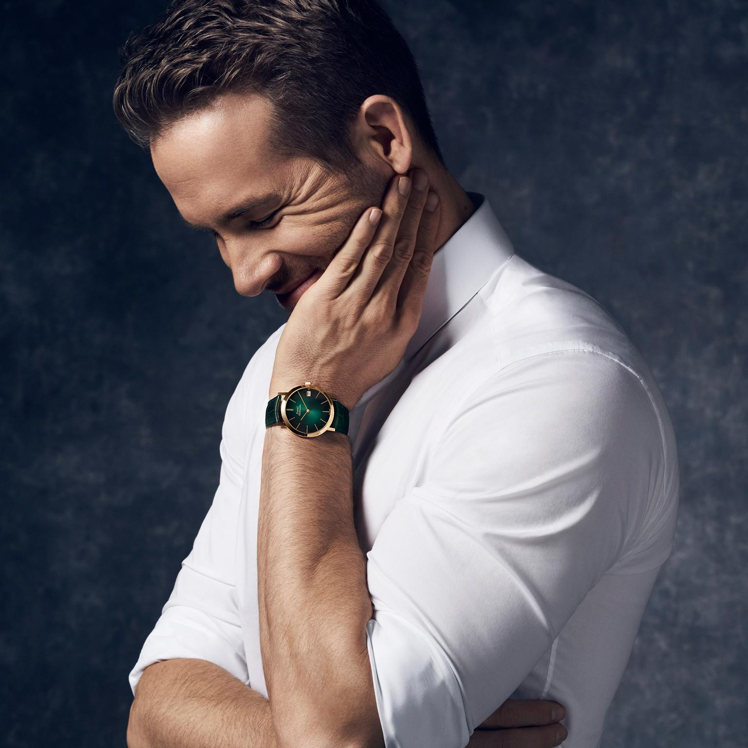 International brand ambassador Ryan Reynolds wears a Piaget Altiplano watch with a green dial