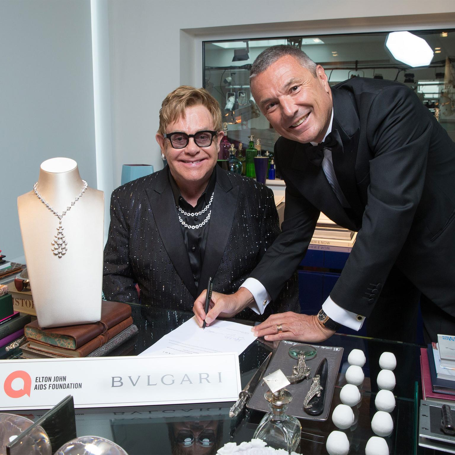 Sir Elton John and Jean Christophe Babin with Bulgari's Diva's Dream necklace