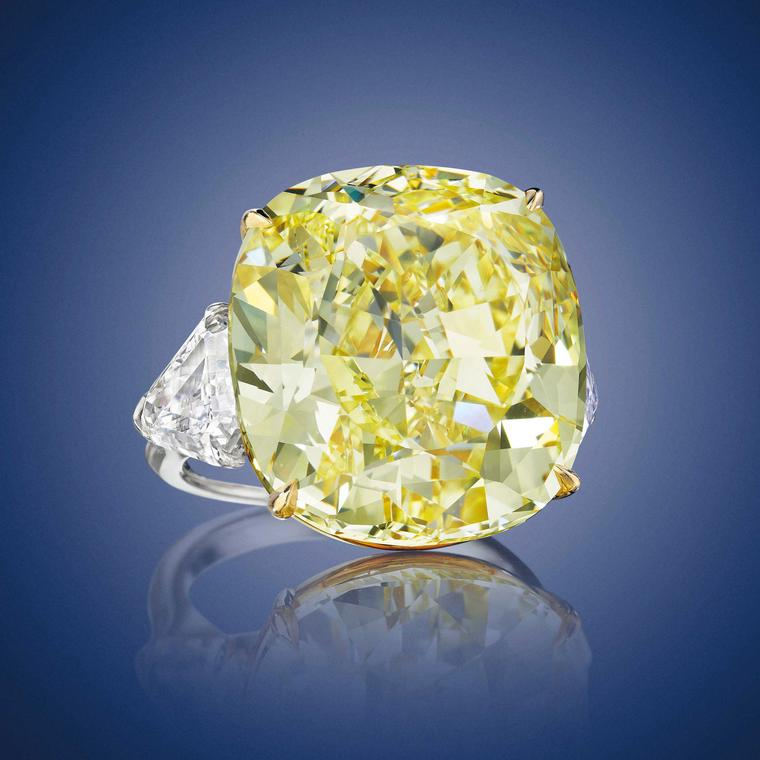 Cushion-cut fancy intense yellow diamond ring