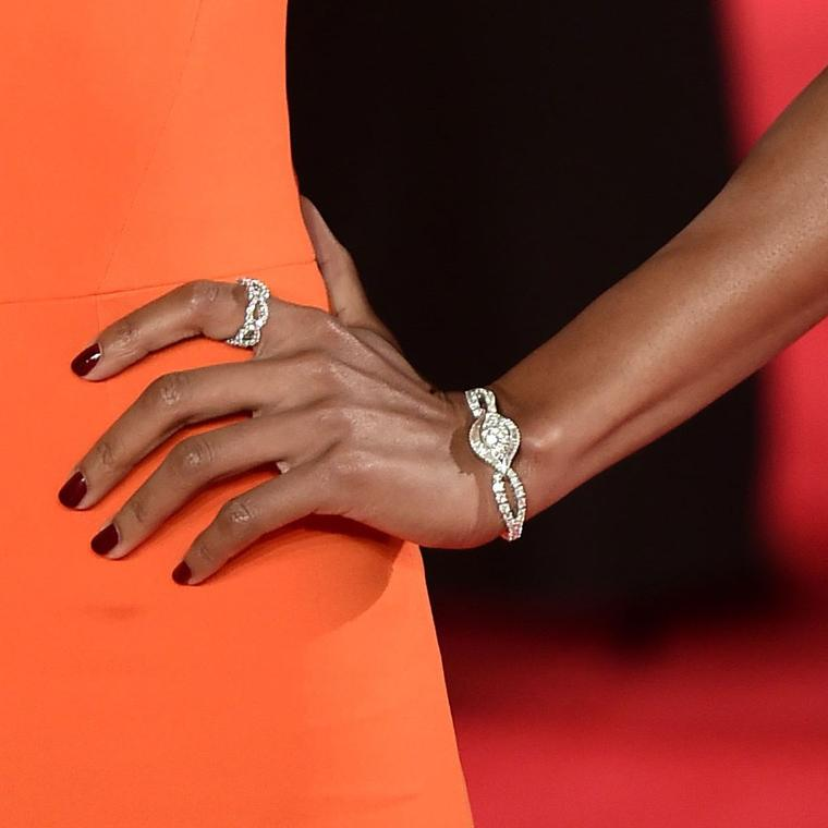 Omega Secret watch and Harry Winston ring worn by Naomie Harris