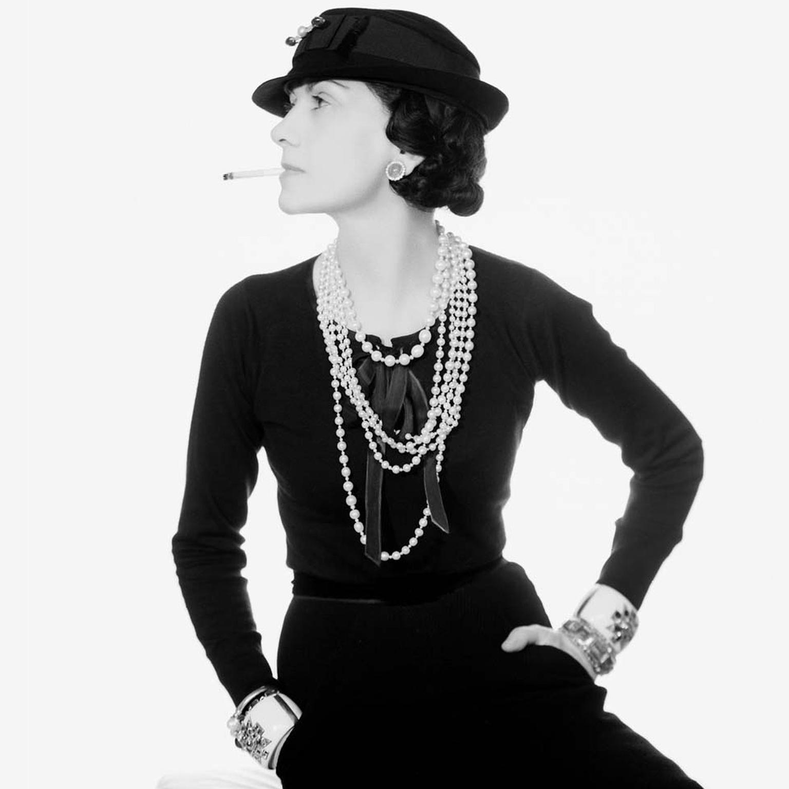 The legendary Coco Chanel, both a friend and muse to Fulco di Verdura, pictured in one of her most iconic photographs wearing her Maltese cuffs.